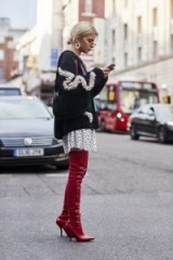 London Fashion Week Street Style Spring 2018 | red over the knee boots worn with black and white applique chunky knit sweater