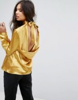 Outrageous Fortune High neck Blouse With Bow Tie Back Detail | silky gold open back blouses