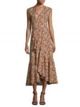 Julianne Hough sleeveless orange and lilac floral print dress, Rebecca Taylor Moonlight-Print Poplin Ruffle Wrap Dress, at Universal Citywalk, 3 October 2017. Celebrity dresses | star style fashion