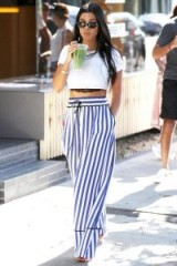Kourtney Kardashian cool summer style…white cotton crop top and blue stripe wide leg trousers.