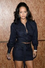 Rihanna wore a Tom Ford dark blue denim cropped blouse with matching mini skirt, attending the Vogue's Forces of Fashion Conference at Milk Studios in New York City, 12 October 2017. Celebrity outfits   star style fashion
