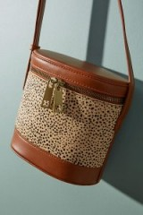 Anthropologie Cylindrical Animal Print Crossbody Bag | stylish shoulder bags