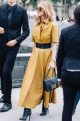 Celine Dion mustard-brown leather dress and Dior handbag / stylish women / celebrity outfits