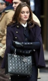 Blair Waldorf stylish a navy cape coat and carrying a Dior handbag