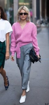 Slouchy pink V-neck jumper and grey checked pants