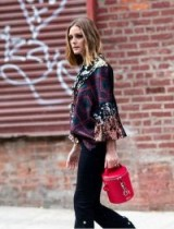Olivia Palermo carrying a Severine Bucket Bag in Poppy Red, available from melimelo.com