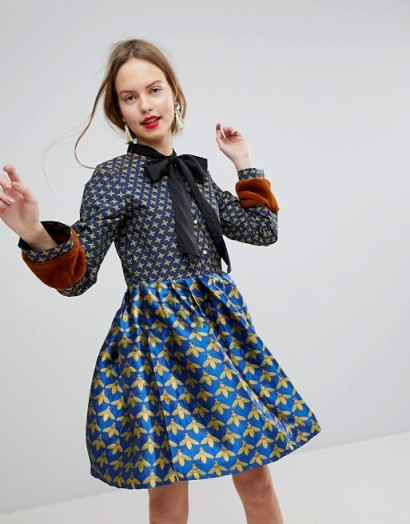 Sister Jane Mini Skater Dress With Faux Fur Cuffs In Jacquard Print – vintage inspired dresses – mixed prints