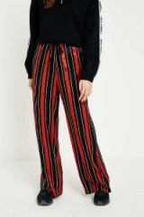 UO Rust and Navy Striped Satin Puddle Trousers – stripe print pants