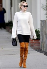 Emma Roberts street style…slouchy jumpers, black skinnies and tan suede over the knee boots