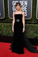 Dakota Johnson wears an elegant, black strappy velvet Gucci gown, with a sequinned train, on the red carpet at the Golden Globes 2018 ~ celebrity dresses