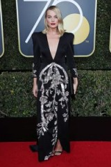Margot Robbie at the 2018 Golden Globe Awards dresses in a black and silver deep V-front Gucci gown ~ designer event dresses ~ celebrity red carpet looks