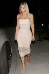 Kim Kardashian style…strapless nude-pink sheath dress and strappy gold sandals