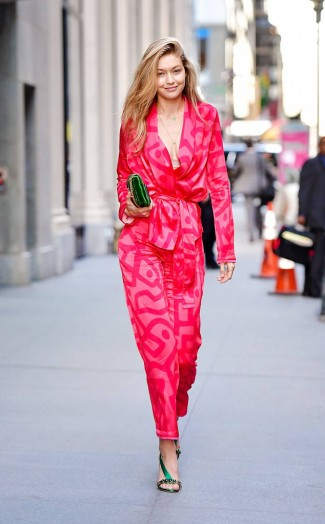 Gigi Hadid street style dressed in hot-pink with emerald-green accessories | model looks