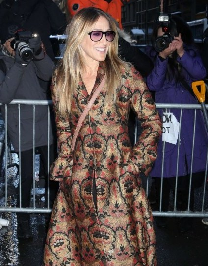 SJP arriving at the Calvin Klein Collection Show 2017 wearing a floral jacquard fit and flare coat - flipped
