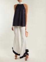 GALVAN Sierra wide-leg high-rise crepe trousers ~ chic flares ~ asymmetric hem