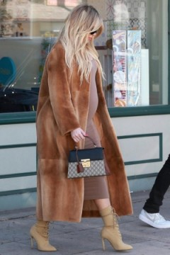 Khloe Kardashian carrying small black and brown handbag, GUCCI Padlock GG Supreme top handle bag, out in Los Angeles, 21 February 2018.