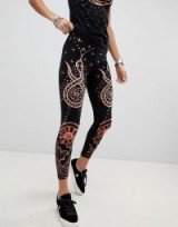Anna Sui Rising Sun and Snake Leggings in black