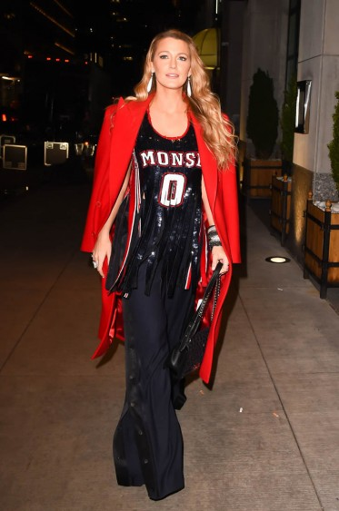 Blake Lively dressed in red and black leaving the NY premiere of All I See Is You, Oct 2017.