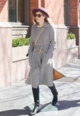 Jessica Biel out in New York wearing a belted dogtooth coat and black eyelet strap biker boots, 22 March 2018. Celebrity street style | star outfits
