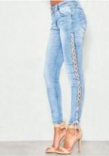 MISSYEMPIRE Helen Denim Light Wash Lace Up Skinny Jeans | side tie skinnies