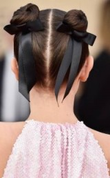 Millie Bobby Brown's hair in cute double buns with black bows at the 2018 SAG Awards