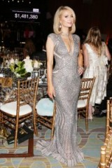 Paris Hilton in a plunging silver sequin gown attends Byron Allens Oscar Gala Viewing Party, March 2018