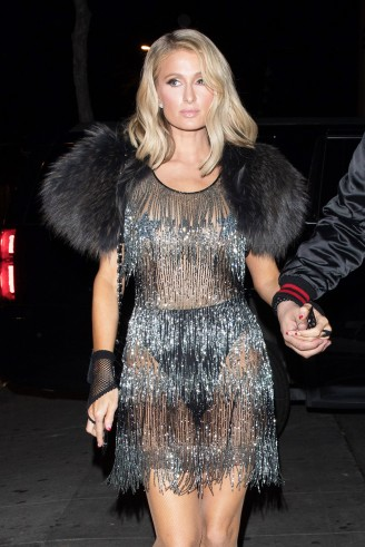 Paris Hilton wearing a sheer fringed dress at the iheart radio award after party in West Hollywood, March 2018