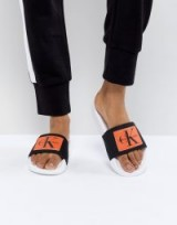 Calvin Klein Chloe Black and Orange Sliders | designer footbed slides