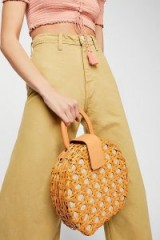 Aranaz Charlie Round Bag. NATURAL STRAW TOP HANDLE BAGS