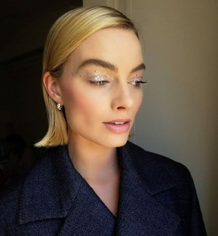 Actress Margo Robbie on Instagram with shiny silver glitter eyeshadow / celebrity shimmering makeup - flipped