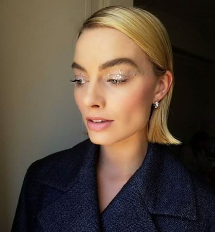 Actress Margo Robbie on Instagram with shiny silver glitter eyeshadow / celebrity shimmering makeup