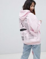 Crooked Tongues Hoodie In Pink With Symbol Print / pink slogan back hoodies