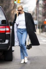 Karlie Kloss white crystal embellished flat shoes, STUART WEITZMAN THE IRISES LOAFER, in New York, 11 April 2018. Celebrity street style | models outfits