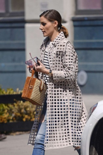 Olivia Palermo street style wearing an AKRIS open grid coat and carrying a Mehry Mu Brown Suede Fey Bamboo Box Bag out in New York City, April 2018.