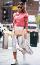 Casual luxe street style ~ metallic pleated skirt, nude Gucci crossbody bag, pink sweatshirt and white sneakers