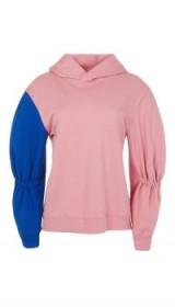 Tibi SCULPTED SLEEVE HOODIE | colourblock hoodies | casual pink hooded tops