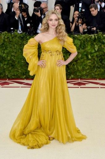 Amanda Seyfried wearing a yellow-gold, Renaissance-style one shoulder gown by Prada ~ Met Gala 2018