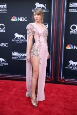 Taylor Swift in a lilac gown with high side split, attends the 2018 Billboard Awards in Las Vegas
