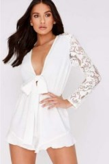 CHARLOTTE CROSBY WHITE TIE FRONT LACE SLEEVE PLAYSUIT – plunging neckline romper