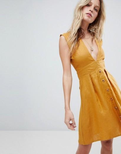 Faithfull Button Front Mini Dress in Plain Marigold – yellow – plunge front – summer style