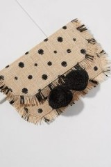 Anthropologie Kinza Embellished-Pommed Clutch | cute neutral toned frayed edge bag