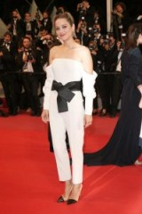 Marion Cotillard wore a white Armani jumpsuit with a black satin statement belt, attending the premiere for 'Angel Face' during the 2018 Cannes Film Festival – French red carpet outfits – star style event fashion