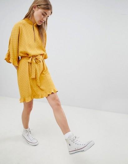 Nobody's Child High Neck Mini Dress With Ruffle Hem Detail in Yellow Polka