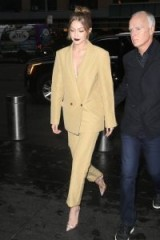 Gigi Hadid wearing an oversized camel blazer and matching trousers | celebrity street style | models outfits | women's trouser suits