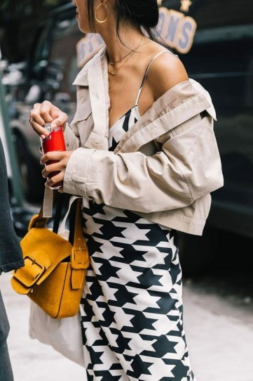 Monochrome print slip dress, stone coloured jacket and a mustard-yellow shoulder bag – best street style outfits