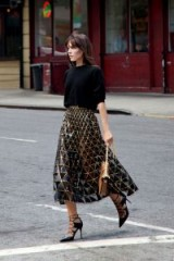 Semi sheer black and metallic-gold midi skirt…this is such a lovely look!