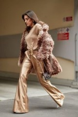 Wow! metallic-gold wide leg pants with tonal top and shaggy jacket…so glamorous