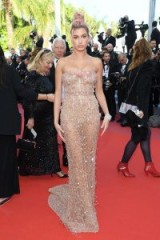 Hailey Baldwin on the red carpet at the 71st annual Cannes Film Festival, wearing a nude embellished, semi sheer strapless gown ~ celebrity glamour