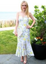 Dakota Fanning frill hem floral sundress, Cinq A Sept Jolene Silk Dress, at DuJour's Memorial Day party in New York, May 2018. Celebrity dresses | star style summer fashion