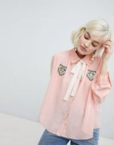 Sister Jane blouse with ribbon tie and heart patch detail in peach – vintage look fashion